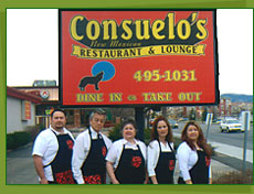 Picture of Consuelo's family outside of restaurant